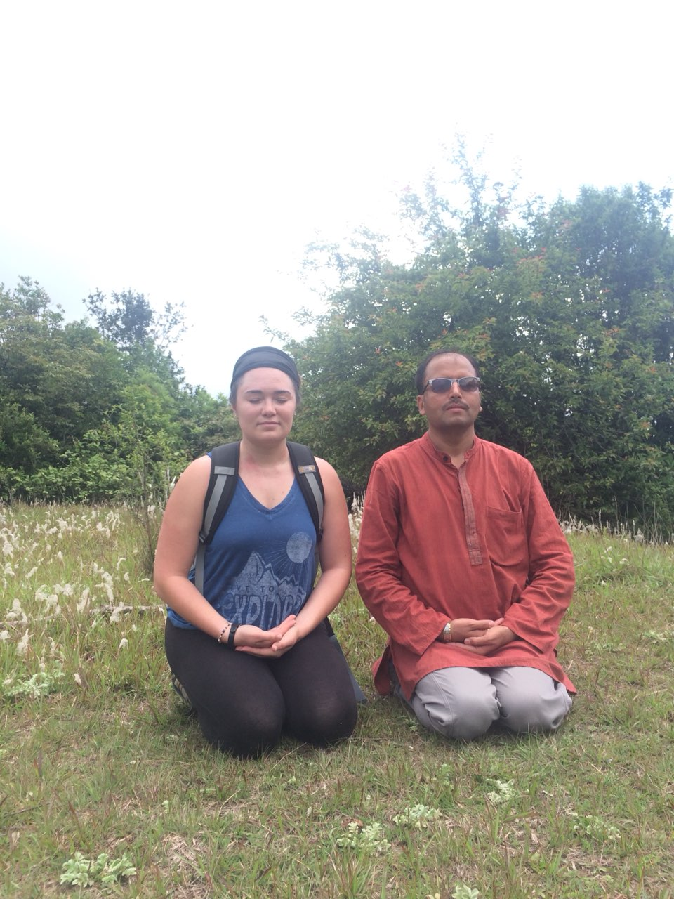 Bajrasana Yoga by Guru and student