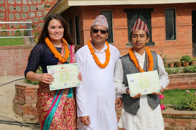 Guru and two students after certificate distribution