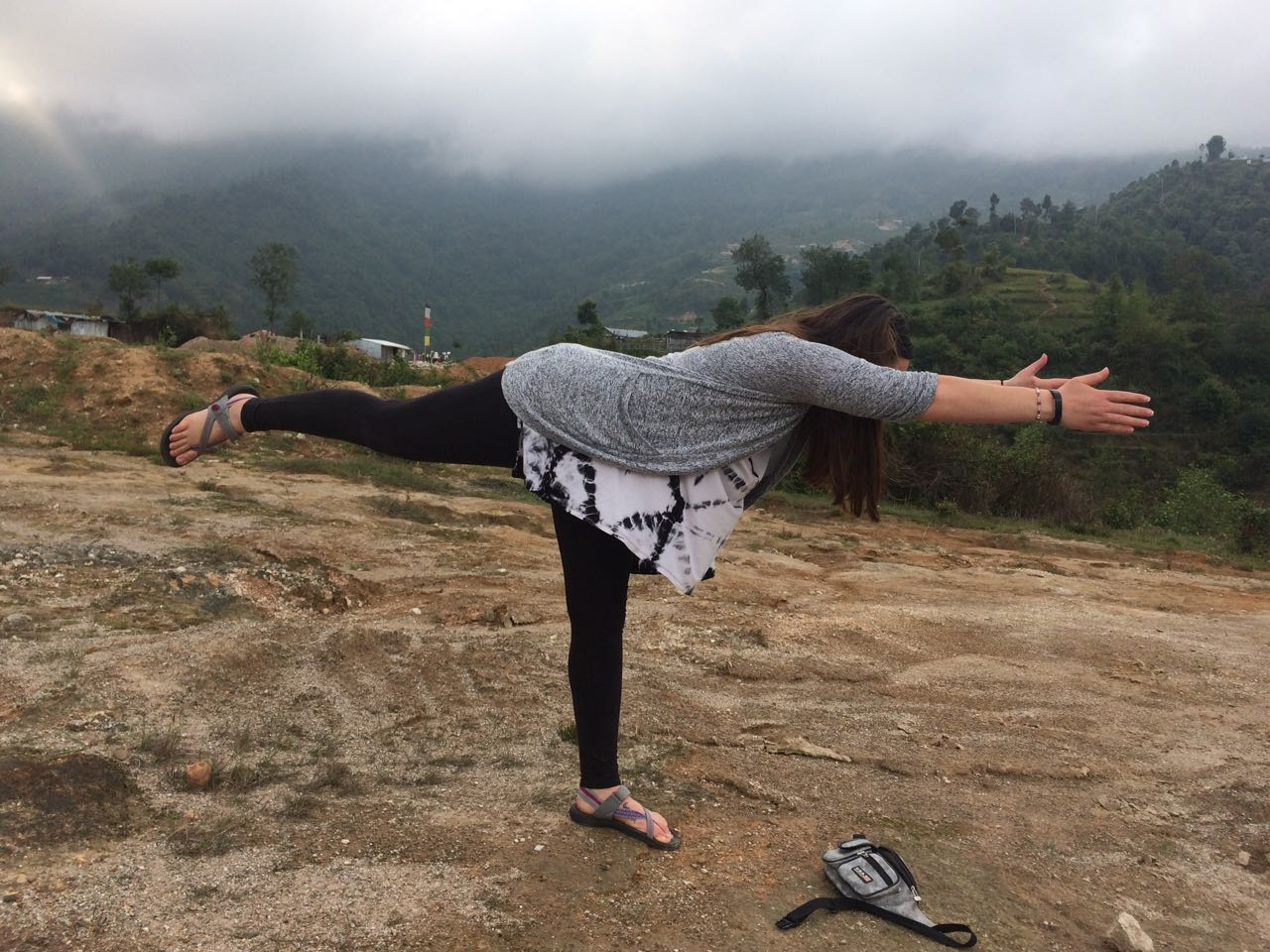 Student performing Peacock Pose on the way while trekking